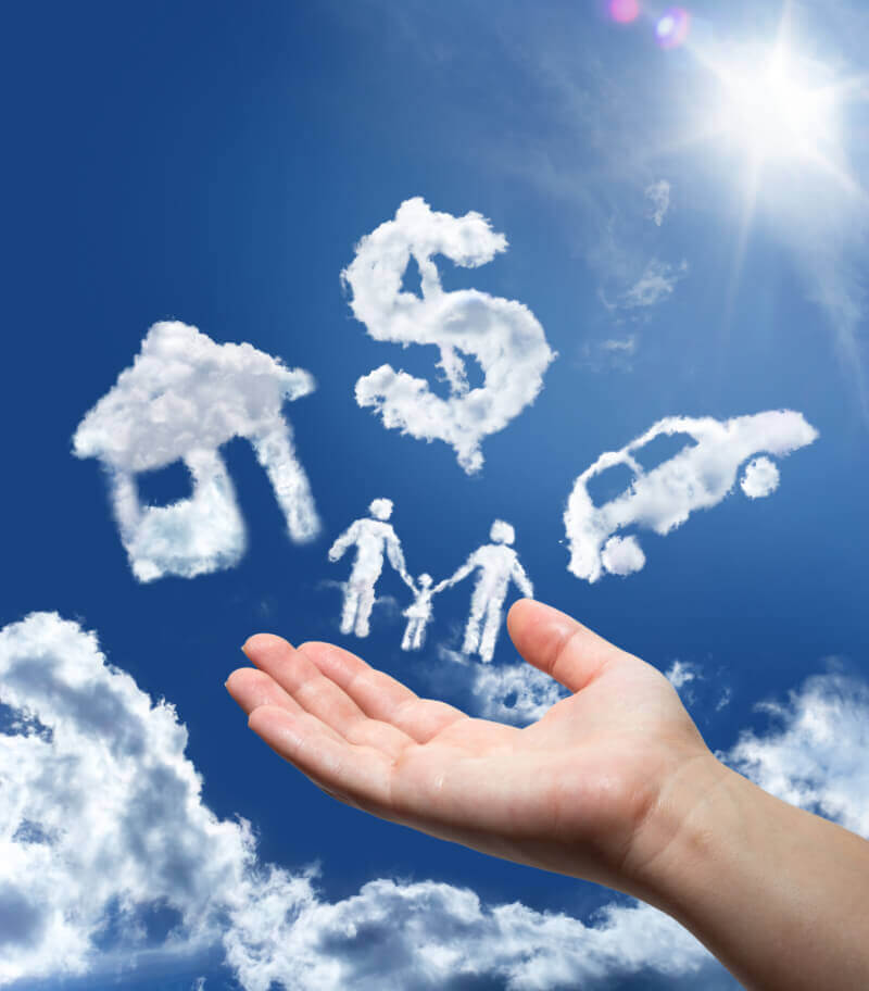 A hand gesturing towards clouds in the form of a home, dollar sign, car and a family
